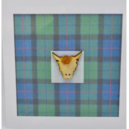 Highland cow head on Tartan backgound - (order code 610)